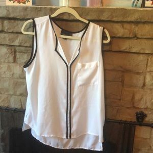 Classic black and white sleeveless blouse